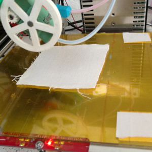 Stick the fabric to your RepRap
